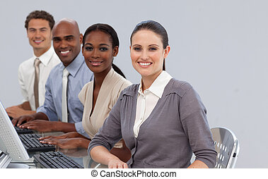 Cheerful international business partners sitting in a line