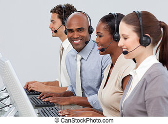 Young business co-workers with headset on showing diversity in a call center