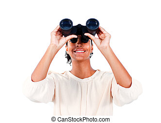 Visionary businesswoman looking through binoculars against a...