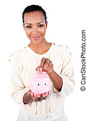 Competitive businesswoman saving money in a piggybank