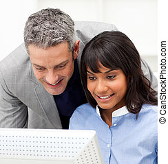 Mature Manager checking his employee\'s work in the office