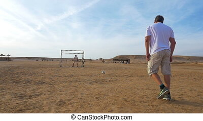 Man shooting and scoring in friendly match