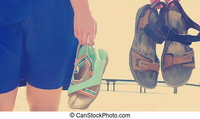 They dont need sandals on the warm beach sand - Slow motion,...