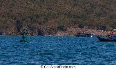 view of drifting along beach and dam-buoy fishing boats -...
