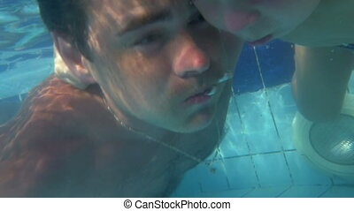 Father and son diving together in the pool - Slow motion and...