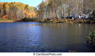 Lake reflections of fall foliage Colorful autumn foliage...
