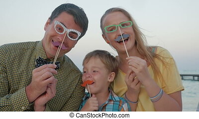 Happy family with hipster accessories outdoor - Slow motion...