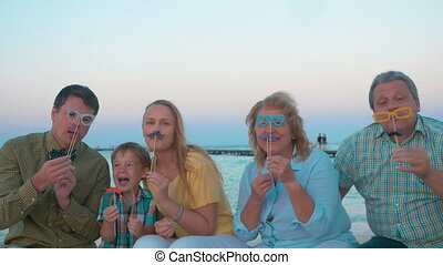 Family Playing with Flase Glasses and Moustache - Slow...