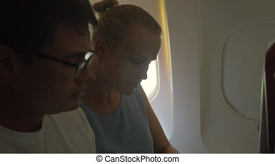 People Looking out the Plane Window - Slow motion shot of...