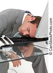 Tired businessman sleeping on his desk against a white...