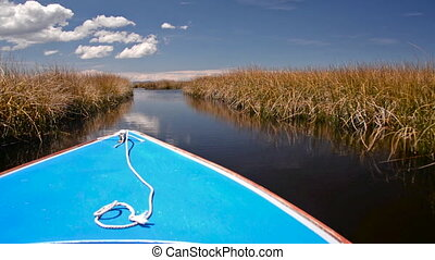 Boat Passing through Reeds - Boat passing through a canal...
