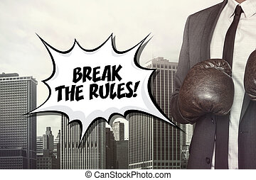 Break the rules text with businessman wearing boxing gloves...