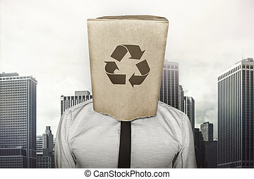 Recycling icon on paper bag what businessman is wearing on...