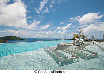 Infinity swimming pool with a view on Phuket Sea.