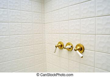Three golden shower valve handles