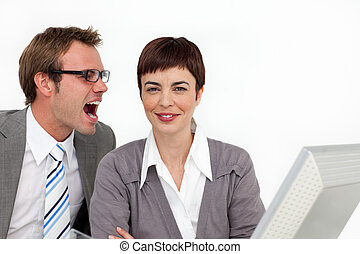 Young businessman shouting into his colleagues ear in the...