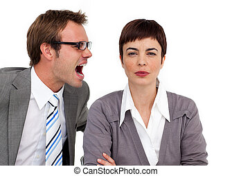 Angry businessman shouting into his colleague\'s ear in the...