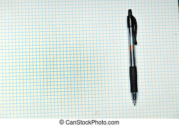 Grid Paper with Pen - Blank grid paper with pen resting on...