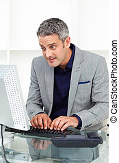 Concentrated businessman working at a computer