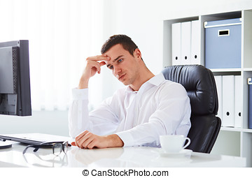 Young business man under stress in the office