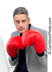 Charismatic businessman with boxing gloves