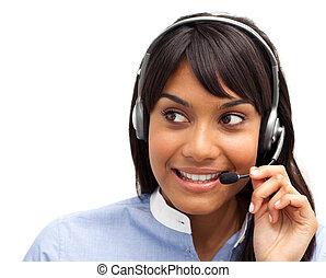 Attractive ethnic customer service representative using headset at a computer
