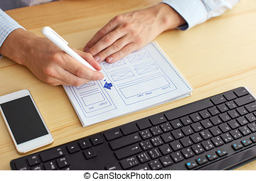 Man sketching on paper web design