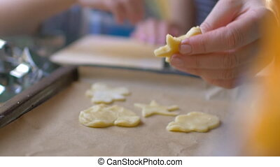 Cutouts of cookie dough on baking tray - Slow motion and...