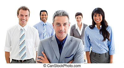 Business partners standing around a table
