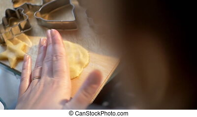 Woman making heart shape from cookie dough - Slow motion and...
