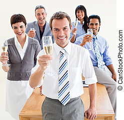 International business people toasting with Champagne in the...