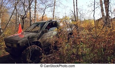 SUV got stuck in the mud and trying to go out in the autumn...