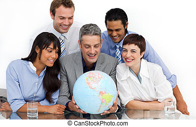 Keen business partners holding a globe