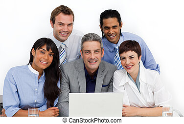 Multi-ethnic business group using a laptop in the office