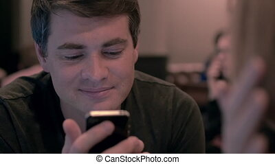 Young man using cell phone with happy look