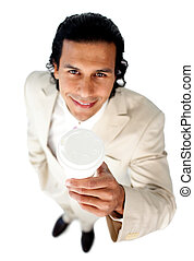 Charming ethnic businessman holding a drinking cup