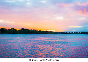 Zambezi river in Zambia - Sunset over Zambezi river in...