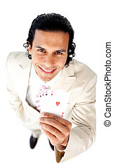 Charming businessman showing a successful hand of cards...