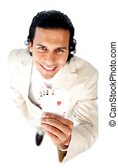 Successful businessman holding all the aces isolated on a...