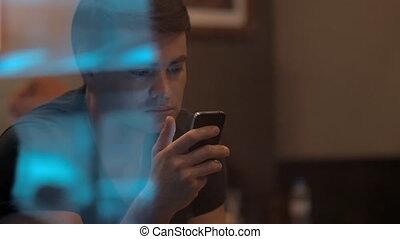 Man Using Smartphone in Cafe - Slow motion shot of a man...