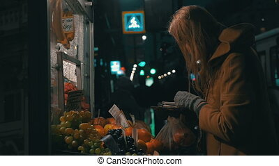 Woman Buying Fruit in Street Stall - Slow motion shot of a...