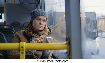 Woman passenger looking out bus window - Slow motion of a...