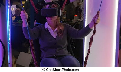 Woman entertaining on VR-attraction