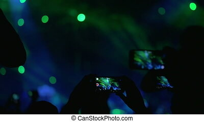 People Shooting the Performance on Smartphones - Slow motion...