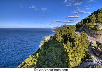 Coast of Mediterranean sea of island Mallorca, road from...
