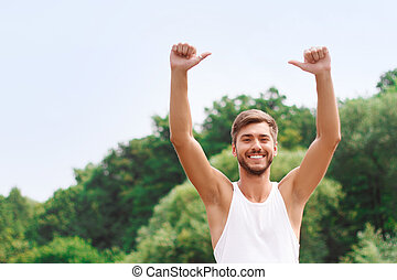 Active guy expressing positivity - Feeling over the moon....