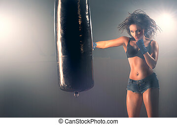 Woman sparring punching bag - Boxing training woman sparring...