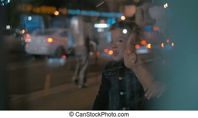 Woman and Boy Waiting for a Bus - Slow motion shot of a...