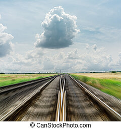 railroad to horizon in dramatic clouds