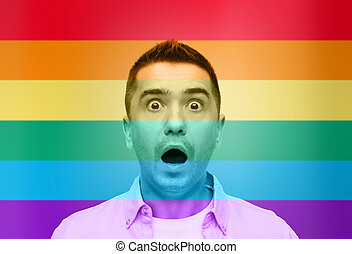 shocked gay man shouting over rainbow flag - homosexual,...